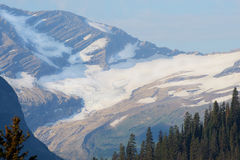 Glacier covers a mountaintop in Glacier National Park. Royalty Free Stock Photography