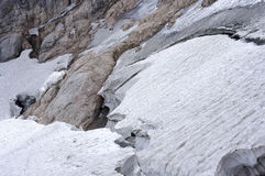 Glacier with cracks on the mountains stock photography