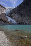 Glacier crawls to the lake Stock Photography