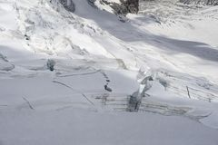 Glacier crevasses and seracs in a snow field in the Mont Blanc a Stock Image