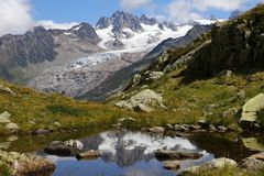 Glacier d`Argentiere reflection in Lac des Cheserys stock photography