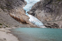 Glacier descending into the lake Stock Photos