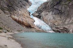 Glacier descending into the lake. In the glacial valley Stock Photos