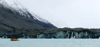 Glacier at the edge of a lake Stock Images
