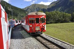 The glacier Express train is driving across the swiss alps and t. Hrough the Unesco World heritage from Brig over St. Moritz to Chur royalty free stock photography