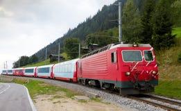 Glacier express train, Switzerland. Glacier express train passes high mountain valley, Switzerland Stock Photos