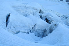 Glacier falling blocks in crack Royalty Free Stock Photography