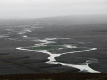 Glacier flood plain in Iceland. Black glacier flood plain called sandur and meandering river flowing into the sea, Skaftafell National Park, Iceland Royalty Free Stock Photos