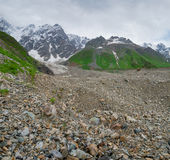 Glacier at the foot of the mountain Shkara Royalty Free Stock Image