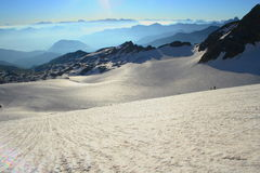 Glacier in the French Alps. A big glacier in the French Alps in front of the pic de l'Etendard. Two small climbers trying to reach the summit Royalty Free Stock Image