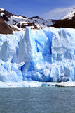 Patagonia Glacier. A glacier in front of a mountain resting on the water of a lake in Patagonia, South America Stock Photos