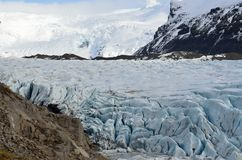Glacier and glacial ice floating in small glacial lagoon, Iceland royalty free stock photo
