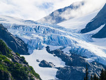 Glacier high in mountain valley Stock Images