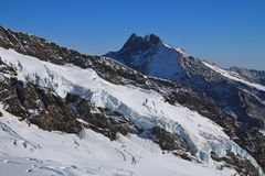Glacier and high mountain, view from the Jungfraujoch. Mountain landscape in the Swiss Alps royalty free stock photo