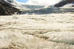 Glacier. Ice of the Athabasca glacier heading into the mountains Stock Photo