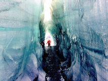 Glacier ice cave in Southern Iceland. Hiking through a deep ice cave on a glacier in southern Iceland stock images
