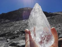 Glacier-ice in hand Royalty Free Stock Image