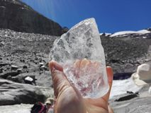 glacier-ice in hand Royalty Free Stock Images