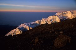 Glacier on Kilimandjaro, Africas highest mountain, during sunrise stock photo