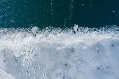 Glacier Lagoon with icebergs from above. Aerial View. Cracked Ice from drone view. Background texture concept royalty free stock image