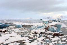 Glacier lagoon in Iceland. Winter with snow-capped mountain as a stock images