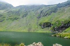 The glacier lake called Balea Balea Lac on the Transfagarasan. Road from Fagaras mountains royalty free stock image