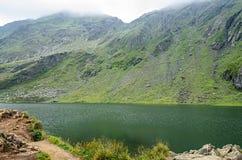 The glacier lake called Balea Balea Lac on the Transfagarasan. Road from Fagaras mountains royalty free stock photography