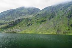 The glacier lake called Balea Balea Lac on the Transfagarasan. Road from Fagaras mountains royalty free stock photo
