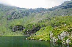 The glacier lake called Balea Balea Lac on the Transfagarasan. Road from Fagaras mountains stock photography