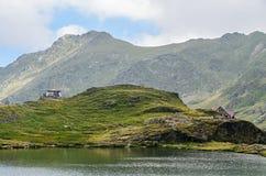 The glacier lake called Balea Balea Lac on the Transfagarasan royalty free stock photo