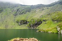 The glacier lake called Balea Balea Lac on the Transfagarasan. Road from Fagaras mountains royalty free stock images