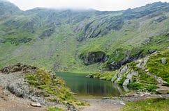 The glacier lake called Balea Balea Lac on the Transfagarasan. Road from Fagaras mountains stock photo
