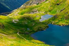 Glacier lake Capra view from above. Lovely scenery of Fagaras mountains in summer Royalty Free Stock Photos