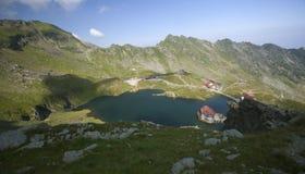 Glacier lake and high mountains in Fagaras, Carpathians,Romania,Europe Stock Photos