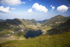 Glacier lake and high mountains in Fagaras, Carpathians,Romania,Europe Stock Image