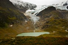 Glacier and Lake in the Swiss Alps Stock Photography