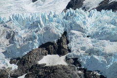 Glacier landscape. Mountain glaciers landscape. High peaks covered with blue ice and white snow. Huge ice blocks falling in Patagonia. Icefalls, massive snow Royalty Free Stock Images