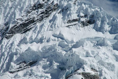 Glacier landscape. Mountain glaciers landscape. High peaks covered with blue ice and white snow. Huge ice blocks falling in Patagonia. Icefalls, massive snow Stock Photos