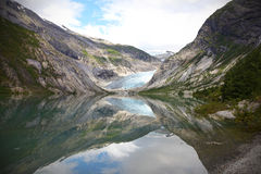 Glacier landscape with reflection in the water Stock Photography