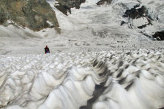 Glacier landscape and small man figure Stock Image