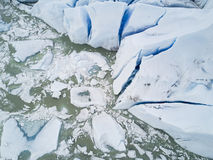 Glacier melting from above. The Mendenhall glacier in Southeast Alaska as seen from above melting into the lake Royalty Free Stock Images