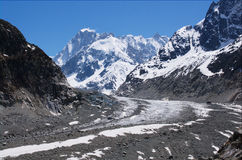 Glacier in Mont-blanc massive. Paraplaner flying  over glacier in Mont-blanc massive, Alps, France, Chamonix Royalty Free Stock Photography
