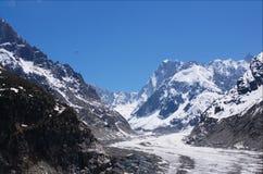 Glacier in Mont-blanc massive. Paraplaner flying  over glacier in Mont-blanc massive, Alps, France, Chamonix Stock Photo