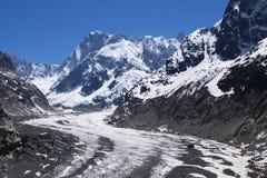 Glacier in Mont-blanc massive. Paraplaner flying  over glacier in Mont-blanc massive, Alps, France, Chamonix Royalty Free Stock Image