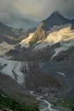 Glacier in morning. This is gloomy glacier in Caucasus mountains in summer Royalty Free Stock Photo