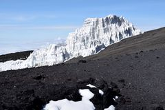 Glacier on Mount Kilimanjaro, Tanzania with rock in foreground. Melting glaciers / climate change Stock Image