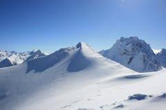 Glacier in mountains. Glacier in the mountains' peak in sunny winter. Place: Russia, Dombai resort Stock Photo