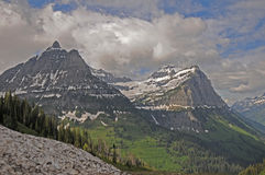 Glacier mountains. Glacier mountain peaks showing slopes of green royalty free stock photo