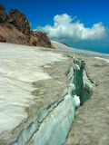 Glacier in mountains. The big crack in a mountain glacier Royalty Free Stock Images