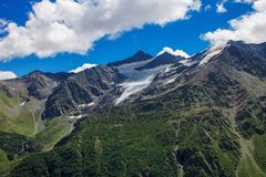 Glacier among the mountains of the North Caucasus. Royalty Free Stock Photos